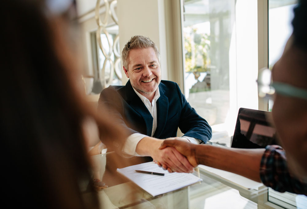 A Financial broker facilitating a home loan deal for a client