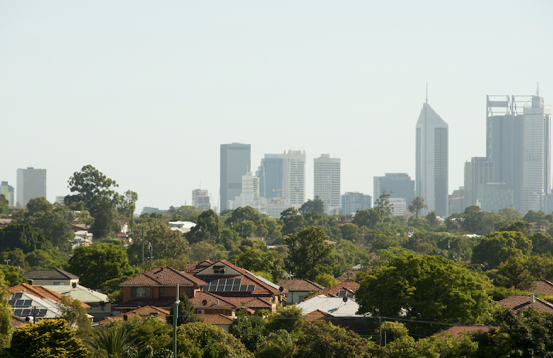 Bushy suburban landscape with Perth city in the background.