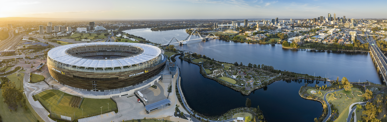 The city of perth from up above with optus stadium in the back drop.