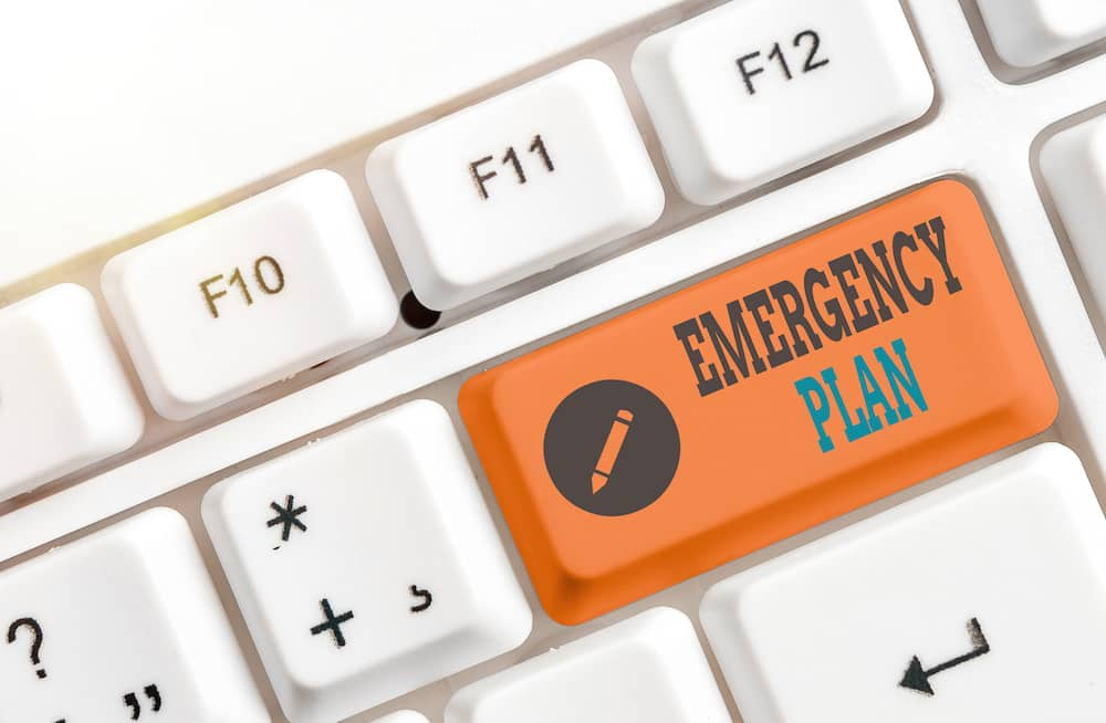Emergency plan button highlighted in orange on a key board.