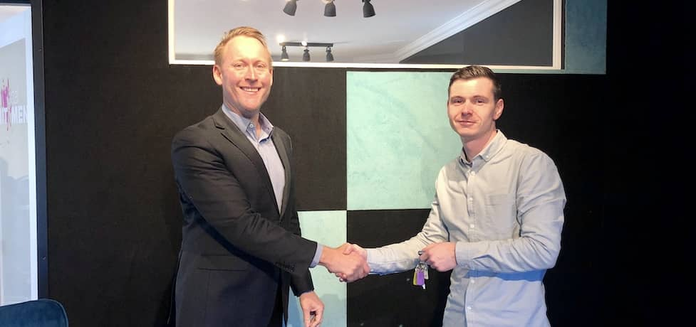 Gavin shaking hands with a client over a home loan.
